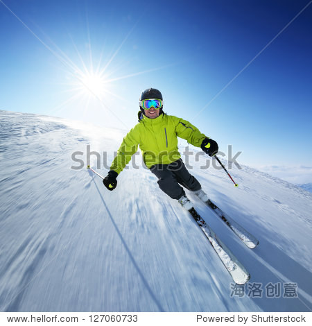 Skier on piste in high mountains