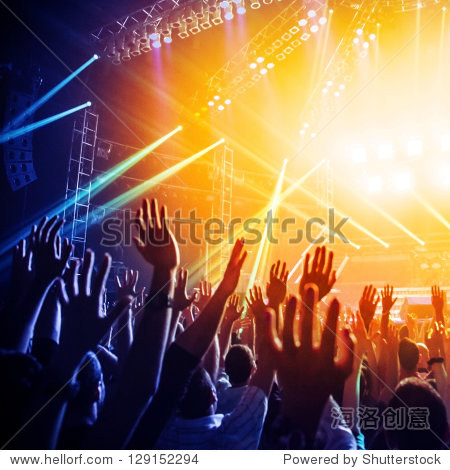 Photo of many people enjoying rock concert  crowd with raised up hands dancing in nightclub  audience applauding to musician band  night entertainment  music festival  happy youth  luxury party