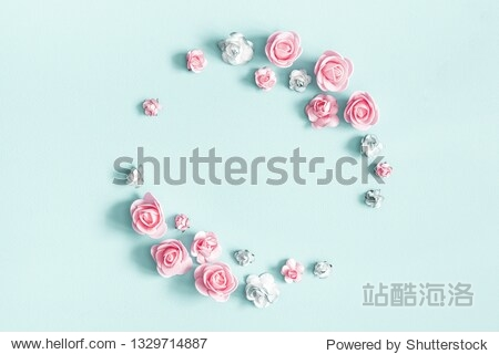 Flowers composition. Wreath made of rose flowers on pastel blue background. Flat lay  top view  copy space