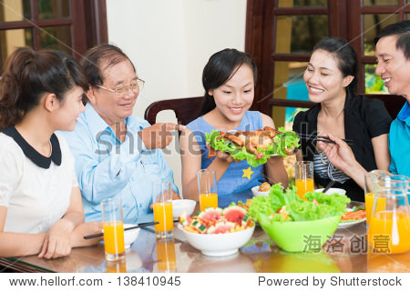 Portrait of a family tasting delicious chicken together