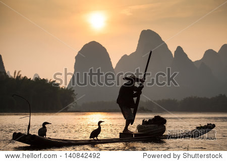 Boat with cormorants birds, traditional fishing in China use trained cormorants to fish, Yangshuo, China