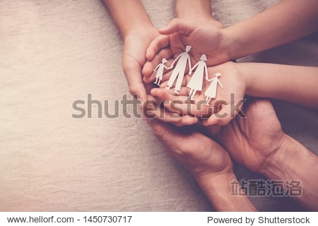 Adult and children hands holding paper family cutout  family home  foster care  homeless support  international day of families concept