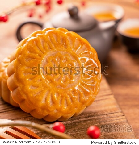 Chinese traditional pastry Moon cake Mooncake with tea cups on bamboo serving tray on wooden background for Mid-Autumn Festival  close up.