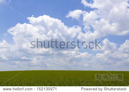 Idyllic Farmland Background with Cloudy Sky
