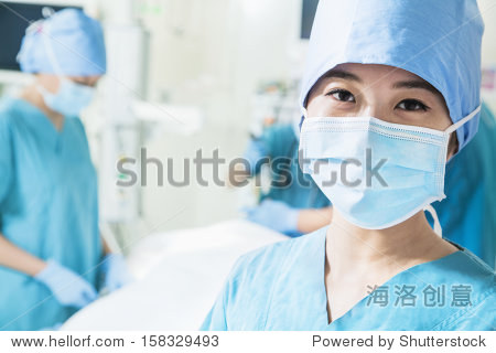 Portrait of female surgeon wearing surgical mask in the operating room