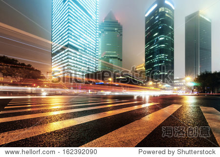 the light trails on the modern building background in china.