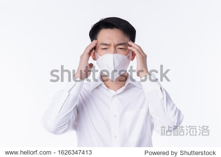 close up young asian male businessman wearing pollution mask with gesture action express ill sickness bad health from weather with pm2.5 environment city air problem