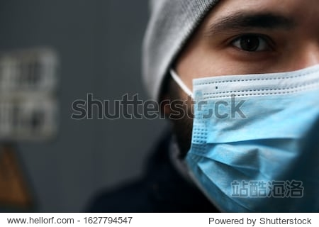 Closeup portrait outdoors of a man in a medical mask who is sick with a virus. Epidemic.