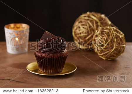 Black chocolate cupcake on black Christmas background