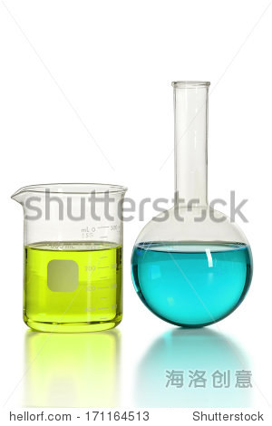 Laboratory beaker and circular flask on reflective table.