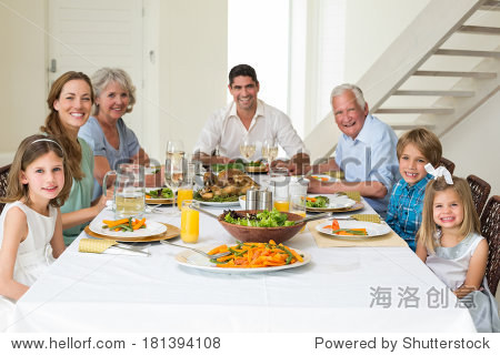 Portrait of smiling multigeneration family having meal together at dining table