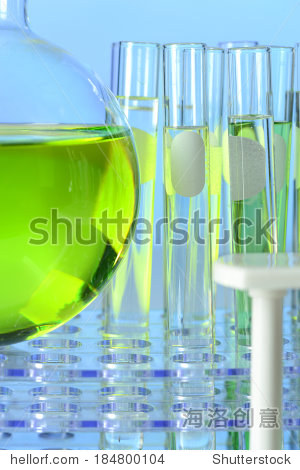 Flask and test tubes with green liquid