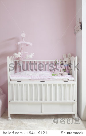 the image of parenting and baby girl crib