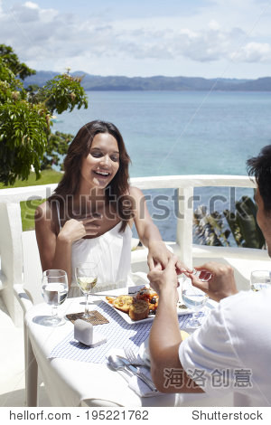 Marriage proposal at restaurant by the sea
