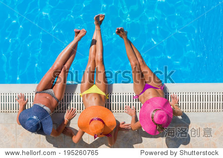 Top view of a  three girls by the swimming pool
