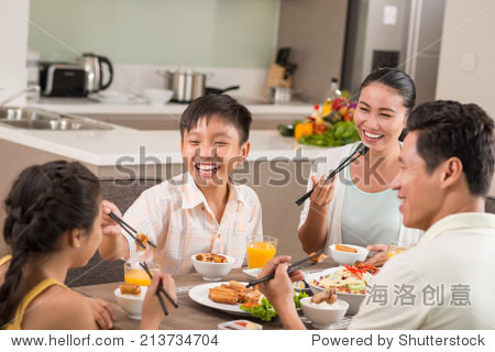 Asian people having fun at the family dinner