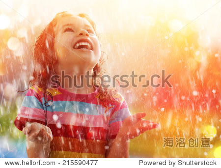 the child is happy with the rain