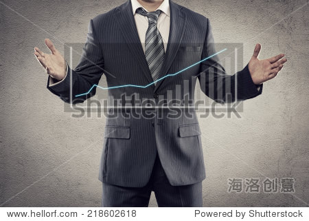 Portrait of young businessman showing flow chart of economic growth on the screen. Male entrepreneur with financial diagram posing in studio.