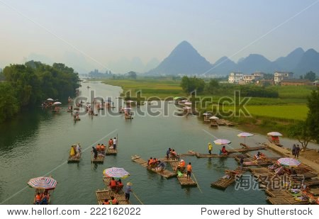 YANGSHUO, CHINA, OCTOBER 4, 2013: Thousands of tourist every year during golden week visit yangshuo region in order to admire karst scenery and have river cruise.