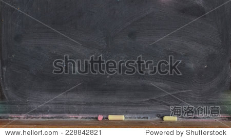 Blank blackboard with colored chalks