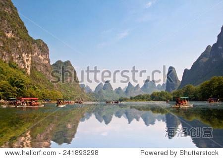 Bamboo rafts on the river Li (lijang) between Guilin and Yangshuo, Guangxi, China