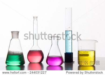 Glass in a chemical laboratory filled with colored liquid - studio shoot