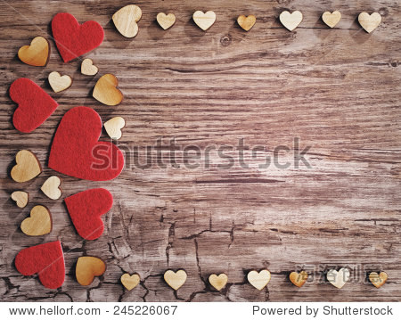 hearts on old wooden background