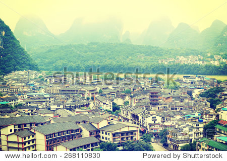 YANGSHUO - AUG 16: Buildings and mountain landscape of west street in yangshuo(the famous destination in china),on AUG 16,2013 at Yangshuo county,guangxi province,China.