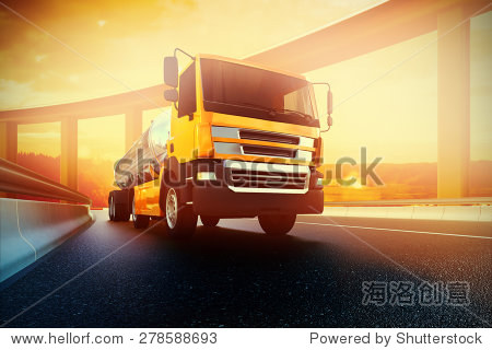 Orange semi truck with oil cistern on asphalt road highway at sunset - transportation background