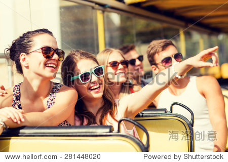 friendship  travel  vacation  summer and people concept - group of smiling friends traveling by tour bus