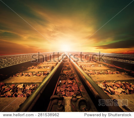 junction of railways track in trains station against beautiful light of sun set sky use for land transport and logistic industry background  backdrop copy space theme