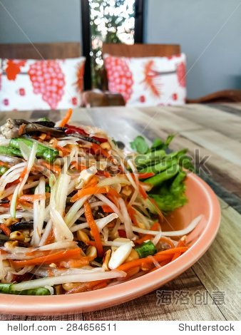 Green papaya salad on wood table.thai food.