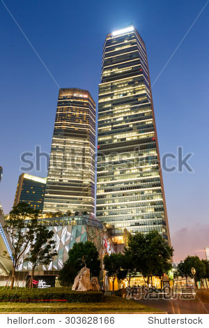 Shanghai, China - on July 28, 2015: Shanghai lujiazui financial district commercial buildings at night, lujiazui is one of the most influential financial center in China.