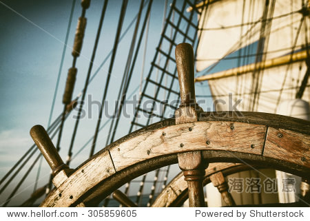 Vintage Helm. Toned image and blur. Retro style postcard. Tall Ship. Yachting.  Sailing