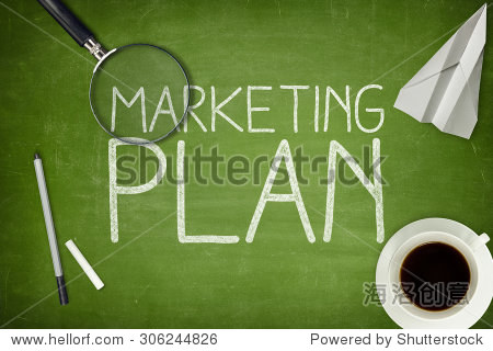 marketing plan concept on green blackboard with coffee cupt and