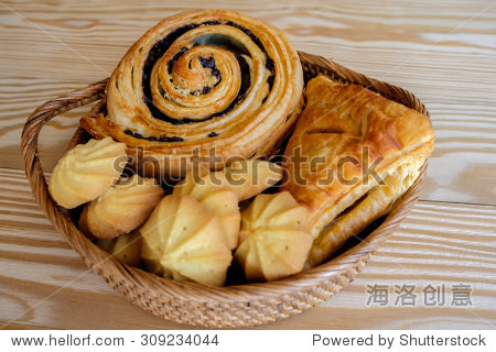 pie and cookie on wood basket with wooden background
