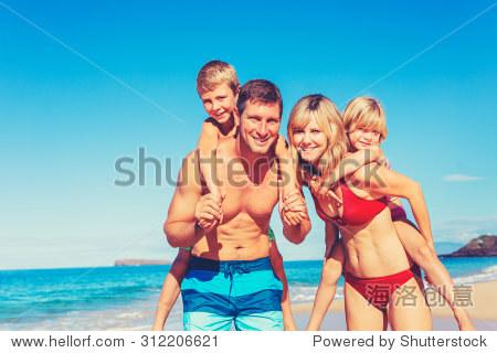 Happy family having fun on beautiful warm sunny beach.