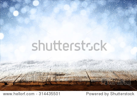 beautiful blue blurred background of winter and shabby table