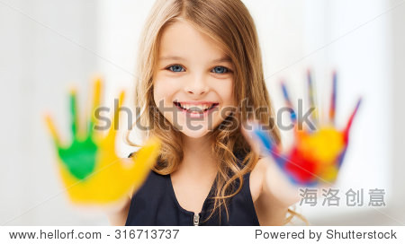education  school  art and painitng concept - smiling little student girl showing painted hands at school