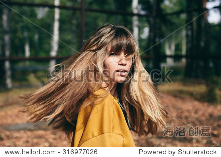 girl with beautiful hair turns around and looks at the camera