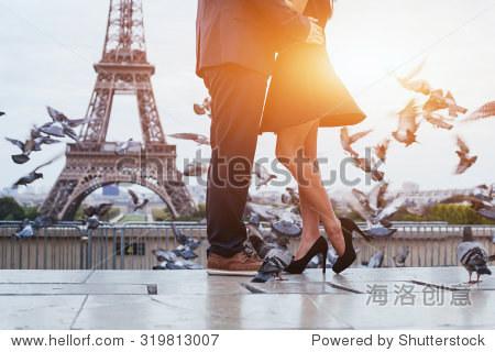 couple near Eiffel tower in Paris  romantic kiss
