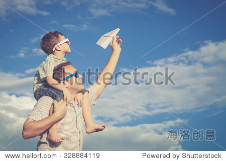 Father and son playing in the park  at the day time. Concept of friendly family.
