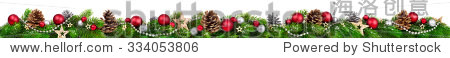 Extra wide Christmas border with fir branches  red and silver baubles  pine cones and other ornaments  isolated on white