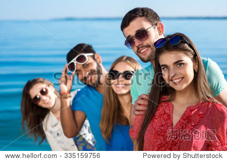 Friends spend a weekend at sea. Beautiful youth smiling. Vacations on the sea. Students are on vacation. Happy people.