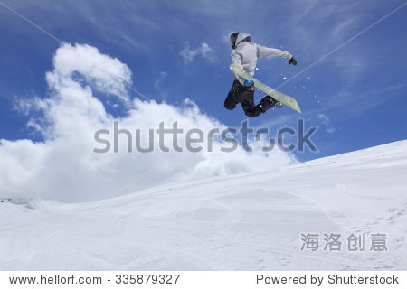 Flying snowboarder on mountains  extreme winter sport