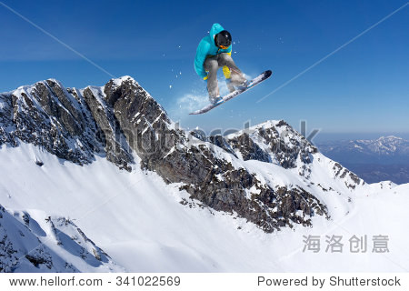 flying snowboarder on mountains. Extreme winter sport