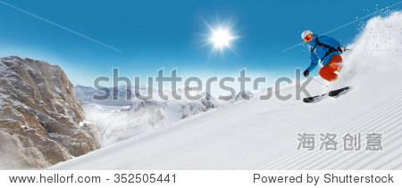 Man skier running downhill on sunny alpine slope