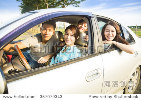 happy young group having fun in the car