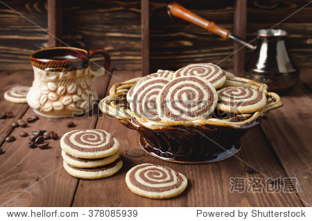 Cookies in the form of a spiral on a wooden table. Handmade biscuits