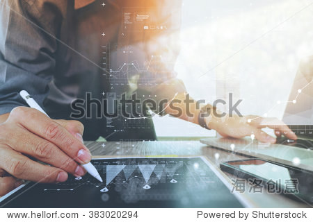 businessman working with digital laptop computer and smart phone with financial business strategy layer effect on wooden desk as concept